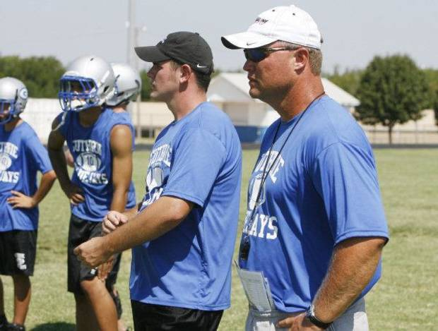 Guthrie Head Coach Rafe Watkins watches his football team practice at Guthrie High School in Guthrie, OK, Thursday, Aug. 12, 2010. By Paul Hellstern, The Oklahoman ORG XMIT: KOD