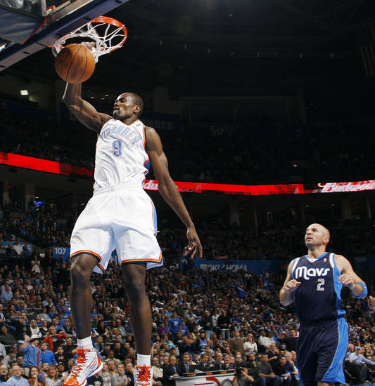 Oklahoma City's Serge Ibaka (9) dunks the ball in front of Jason Kidd (2) of Dallas in the first half of an NBA basketball game between the Oklahoma City Thunder and the Dallas Mavericks at Chesapeake Energy Arena in Oklahoma City, Thursday, Dec. 29, 2011. Photo by Nate Billings, The Oklahoman