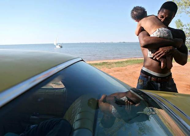 Jay, Melydia and Jay Jr. Miles at Lake Hefner in Oklahoma City, Sunday, July 19, 2009. By John Clanton, The Oklahoman