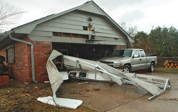 Damage to a house at 5213 Circle Glenn that was damage by the tornado that hit north Edmond on Tuesday, Feb. 10, 2009, in Edmond, Okla.  PHOTO BY CHRIS LANDSBERGER, THE OKLAHOMAN
