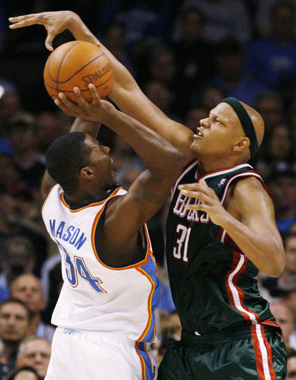 Charlie Villanueva (31) of the Bucks fouls Desmond Mason (34) of the Thunder during the NBA basketball game between the Oklahoma City Thunder and the Milwaukee Bucks at the Ford Center in Oklahoma City, Wednesday, Oct. 29, 2008. This was the regular season debut of the Thunder. Milwaukee won, 98-87. BY NATE BILLINGS, THE OKLAHOMAN