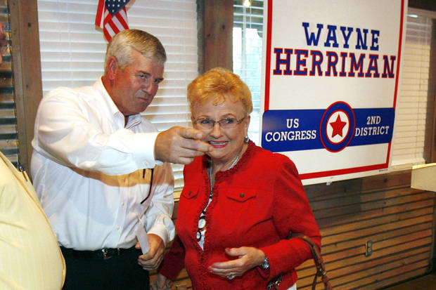Congressional candidate Wayne Herriman (left) greets supporter Naomi Lynch at a watch party at Cowboy's BBQ in Muskogee, Okla. on Tuesday, August 28, 2012. MATT BARNARD/Tulsa World