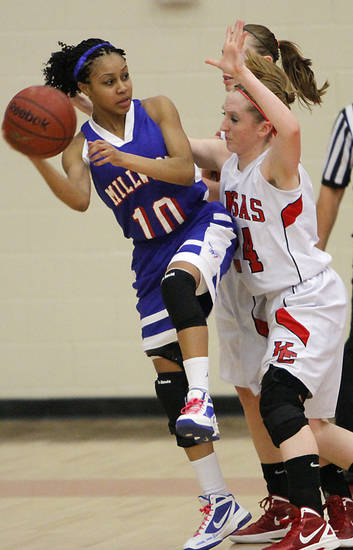 CLASS 3A / GIRLS HIGH SCHOOL BASKETBALL / STATE TOURNAMENT: Millwood&#039;s Teanna Reid (10) tries to get the ball past Kansas&#039; Keely Kerns (24) during the semifinal 3A girls State Basketball Championship game between Millwood High School and Kansas High School at Yukon High School on Friday, March 9, 2012 in Yukon, Okla.  Photo by Chris Landsberger, The Oklahoman