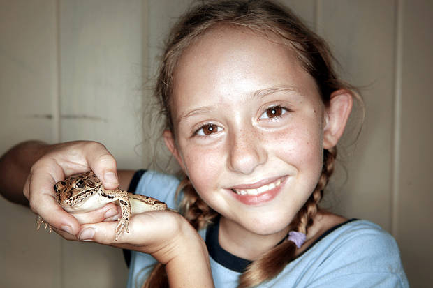 Lauren Cochell, 7, shows her frog.