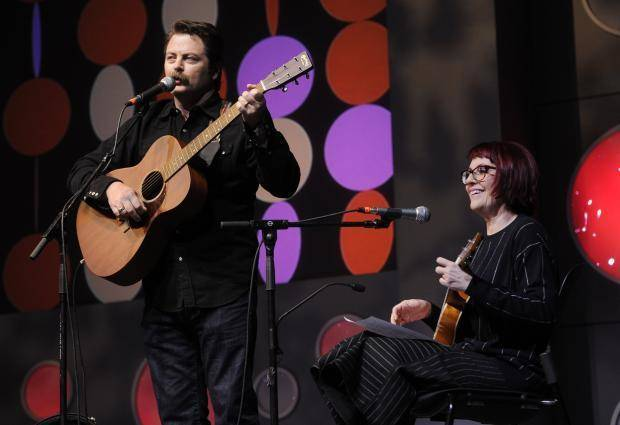 Co-hosts Nick Offerman, left, and his wife Megan Mullally perform together during the 2014 Sundance Film Festival Awards Ceremony on Saturday, Jan. 25, 2014, in Park City, Utah. (AP)