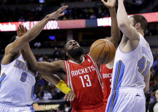 Houston Rockets guard James Harden (13) loses the basketball between Denver Nuggets forward Andre Iguodala (9) and center Kosta Koufos (41) during the first quarter of an NBA game, Wednesday, Jan. 30, 2013, in Denver. (AP Photo/Joe Mahoney)