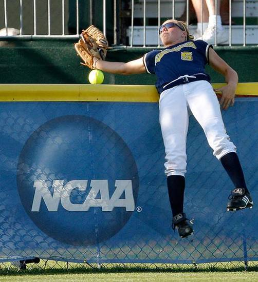 Michigan's Bree Evans misses the ball on a home run in the first inning of the Women's College World Series softball game between Georgia and Michigan at the ASA Hall of Fame Stadium in Oklahoma City, Saturday, May 30, 2009. Photo by Bryan Terry, The Oklahoman