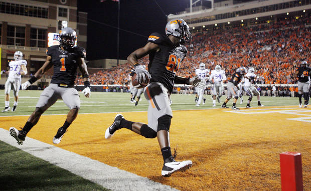 Oklahoma State's Justin Blackmon (81) runs through the end zone in front of Joseph Randle (1) after scoring a touchdown in the first quarter during a college football game between the Oklahoma State University Cowboys (OSU) and the Kansas State University Wildcats (KSU) at Boone Pickens Stadium in Stillwater, Okla., Saturday, Nov. 5, 2011.  Photo by Nate Billings, The Oklahoman
