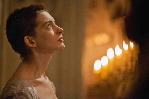 """This film image released by Universal Pictures shows actress Anne Hathaway portraying Fantine, a struggling, sickly mother forced into prostitution in 1800s Paris, in a scene from the screen adaptation of """"Les Miserables.""""  Hathaway was nominated Thursday, Dec. 13, 2012 for a Golden Globe for best supporting actress for her role in """"Les Miserables.""""  The 70th annual Golden Globe Awards will be held on Jan. 13. (AP Photo/Universal Pictures, Laurie Sparham) ORG XMIT: NYET714"""