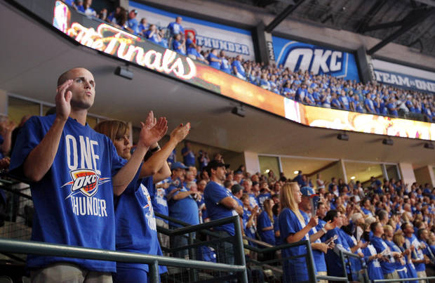 Fans Jake Rutherford, of Edmond, left, and Alyssa Geis, of Oklahoma City, cheer with other fans before Game 1 of the NBA Finals between the Oklahoma City Thunder and the Miami Heat at Chesapeake Energy Arena in Oklahoma City, Tuesday, June 12, 2012. Photo by Nate Billings, The Oklahoman