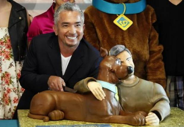 "Cesar  Millan, dog behavior specialist and host of the television series ""The Dog Whisperer,"" cuts his birthday cake while celebrating his 40th birthday with a Scooby-Doo cake at the East Valley Animal Shelter in Los Angeles on Tuesday Sept. 8,2009. AP Photo"
