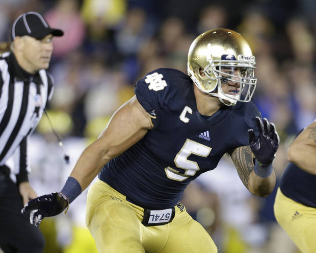 In this Sept. 22, 2012 photo, Notre Dame's Manti Te'o (5) pursues the football during the first half of an NCAA college football game against Michigan, in South Bend, Ind. Notre Dame defensive coordinator Bob Diaco believes Manti Te�o is the finest football player in college. (AP Photo/Darron Cummings)