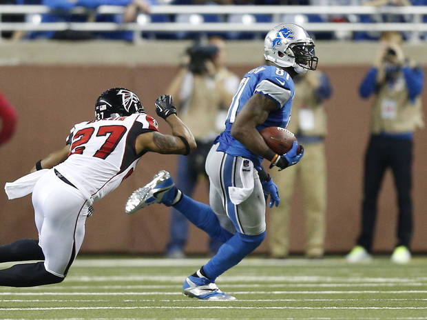 Detroit Lions wide receiver Calvin Johnson (81) breaks away from Atlanta Falcons cornerback Robert McClain (27) in the fourth quarter of an NFL football game at Ford Field in Detroit, Saturday, Dec. 22, 2012. (AP Photo/Rick Osentoski)
