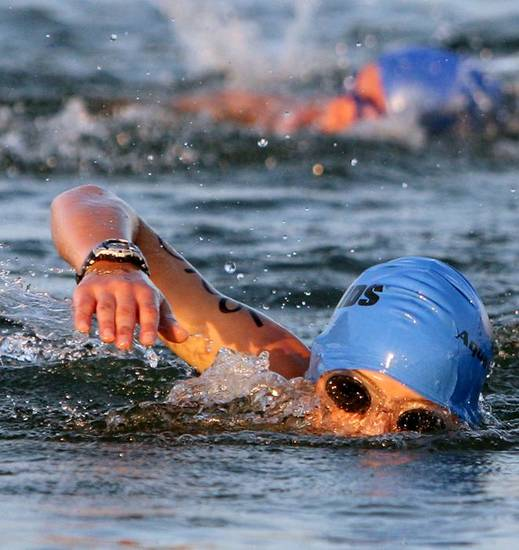 Matthew McDonald swims in Lake Hefner during the IronKids Oklahoma City Triathlon at Lake Hefner in Oklahoma City on Sunday, August 22,  2010. Photo by John Clanton, The Oklahoman