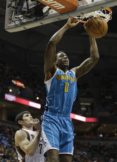 New Orleans Hornets' Al-Farouq Aminu(0) dunks the ball against Milwaukee Bucks' Ersan Ilyasova during the first half of an NBA basketball game Saturday, Nov. 17, 2012, in Milwaukee. (AP Photo/Jeffrey Phelps)