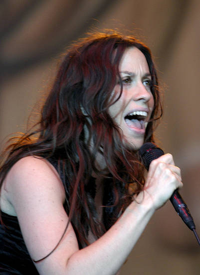 Canadian singer Alanis Morisette performs during the first concert of her tour through Germany in Dresden, eastern Germany, Wednesday evening, July 2, 2003. (AP Photo/Matthias Rietschel)