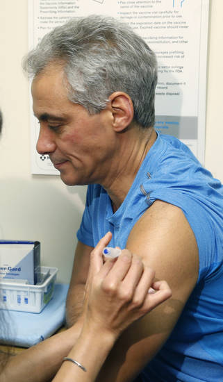 Chicago Mayor Rahm Emanuel receives a flu shot from Dr. Julie Morita, Director of Immunizations at the Chicago Dept. of Public Health, at a North Side clinic Friday, Jan. 11, 2013, in Chicago. (AP Photo/Charles Rex Arbogast)