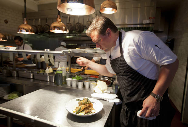 n this photo taken Monday, Oct. 29, 2012, chef Tyler Florence puts a finishing touch to his fried chicken dish in the kitchen at his Wayfare Tavern in San Francisco. Baby food and fried chicken may well be the legacy for which Tyler Florence ultimately is best known. Which seems a bit crazy given his near ubiquity on the Food Network since its earliest days on air, his years of running the celebrity chef gauntlet, his many cookbooks, product lines and appearances.  (AP Photo/Eric Risberg)