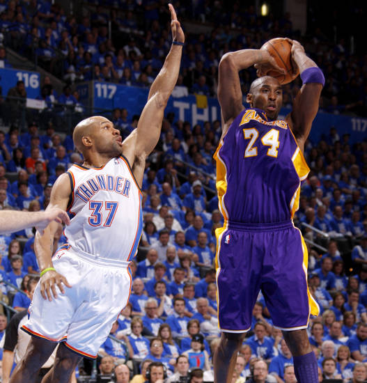 Oklahoma City's Derek Fisher (37) defends Los Angeles' Kobe Bryant (24) during Game 1 in the second round of the NBA playoffs between the Oklahoma City Thunder and L.A. Lakers at Chesapeake Energy Arena in Oklahoma City, Monday, May 14, 2012. Photo by Bryan Terry, The Oklahoman