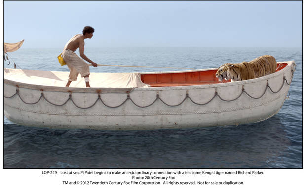 "Pi (Suraj Sharma) faces off with a Bengal tiger in the confines of a lifeboat in the middle of the Pacific Ocean in ""Life of Pi."" TWENTIETH CENTURY FOX PHOTO <strong></strong>"