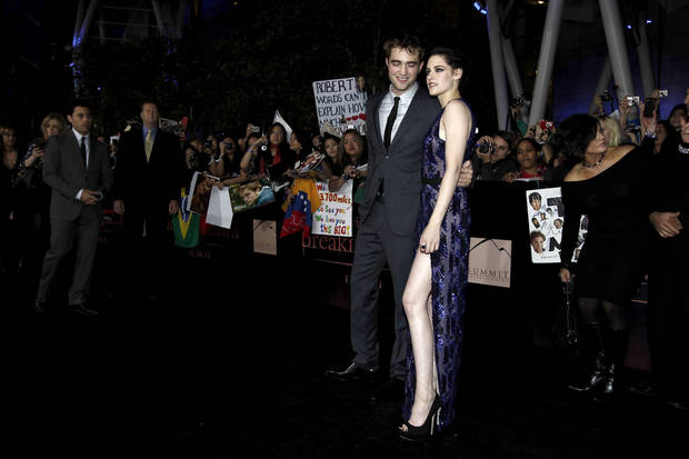 "Robert Pattinson, left, and Kristen Stewart arrive at the world premiere of ""The Twilight Saga: Breaking Dawn - Part 1"" on Monday, Nov. 14, 2011, in Los Angeles. (AP Photo/Matt Sayles) ORG XMIT: CASH199"