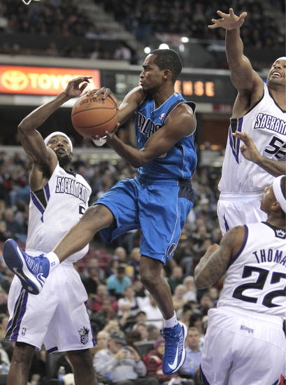 Dallas Mavericks guard Rodrigue Beaubois, of France, center, drives between Sacramento Kings' John Salmons, left, James Johnson, right, and Isaiah Thomas, foreground right, during  the first quarter of an NBA basketball game in Sacramento, Calif., Thursday, Jan. 10, 2013. (AP Photo/Rich Pedroncelli