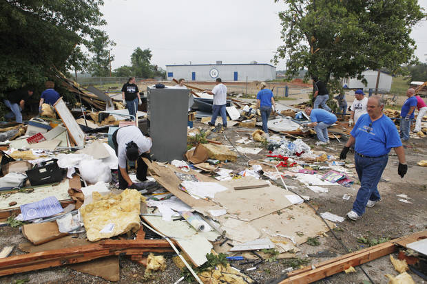 Students, teachers and administrators sifts the debris of portable classroom  at Little Axe School, Tuesday, May 11, 2010. The school was hit by a tornado Monday, May 10, 2010. Photo by David McDaniel, The Oklahoman