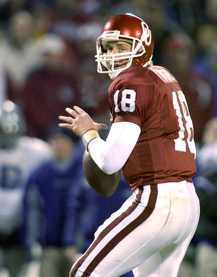 UNIVERSITY OF OKLAHOMA VS  KANSAS STATE UNIVERSITY BIG 12 CHAMPIONSHIP COLLEGE FOOTBALL AT ARROWHEAD  STADIUM IN KANSAS CITY, MISSOURI, DECEMBER 6, 2003.  OU Sooner #18 Jason White drops back for a pass against KSU.  Staff photo by Ty Russell