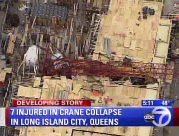 This aerial photo provided by WABC News Channel 7 shows the scene of a crane collapse at a construction site in the Queens borough of New York, Wednesday, Jan. 9, 2013. The Fire Department of New York says the 200-foot crane collapsed onto a building under construction, injuring seven people, three of them seriously.  (AP Photo/WABC News Channel 7) MANDATORY CREDIT