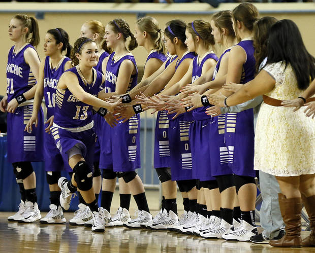 Okarche's Rae Grellner (13) greets teammates during introductions before a Class A Girls semifinal game of the state high school basketball tournament between Okarche and Turner at Jim Norick Arena, The Big House, on State Fair Park in Oklahoma City, Friday, March 1, 2013. Photo by Nate Billings, The Oklahoman