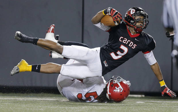 East Central's Deontre Youngblood (3) goes over the top of Carl Albert's Bryan Williams (5) during the Class 5A Oklahoma state championship football game between Carl Albert High School and Tulsa East Central High School at Boone Pickens Stadium on Saturday, Dec. 1, 2012, in Stillwater, Okla.   Photo by Chris Landsberger, The Oklahoman