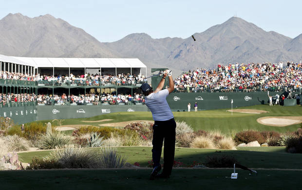 Phil Mickelson hits his tee shot at the 16th hole during the second round of the Waste Management Phoenix Open golf tournament on Friday, Feb. 1, 2013, in Scottsdale, Ariz. (AP Photo/Ross D. Franklin)