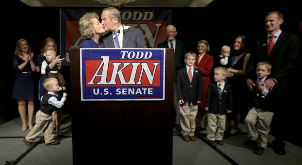 U.S. Senate candidate, Rep. Todd Akin, R-Mo., and his wife Lulli kiss before Akin makes his concession speech to U.S. Sen. Claire McCaskill, D-Mo. Tuesday, Nov. 6, 2012, in Chesterfield, Mo. (AP Photo/Charlie Riedel)