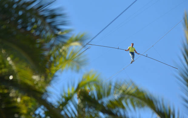 Aerialist Nik Wallenda walks the high wire 200 feet over U.S. 41 in Sarasota, Fla., without a safety harness on Tuesday, Jan. 29, 2013.  The Sarasota City Commission is allowing him to do the stunt without a tether. Wallenda wore a tether for the first time last summer when he walked across Niagara Falls because the television network that was paying for the performance insisted on it. (AP Photo/Sarasota Herald-Tribune, Mike Lang)  PORT CHARLOTTE OUT; BRADENTON HERALD OUT; TV OUT;  ONLINE OUT