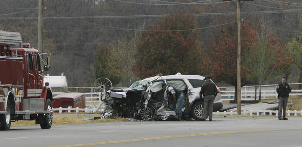 Officials work the scene of a wreck involving multiple fatalities according to the police on highway 33 west of the I-44 Kellyville exit near Kellyville, Okla., taken on November 11,2012. JAMES GIBBARD/Tulsa World ORG XMIT: DTI1211111505592215