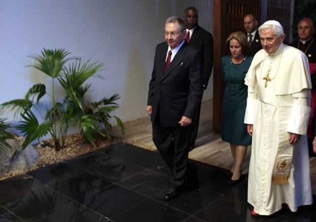 Cuba's President Raul Castro, left, wlaks next to Pope Benedict XVI during a meeting in Havana, Cuba, Tuesday, March 27, 2012.  The meeting took place behind closed doors on the pontiff's second day on the island.(AP Photo/Ismael Francisco, Cubadebate) ORG XMIT: XEM103