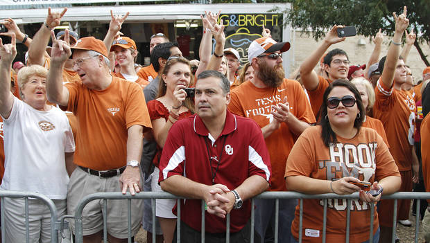 Marlin Coffee is surrounded by Texas fans as he waits for the Sooner team bus to arrive during the Red River Rivalry college football game between the University of Oklahoma (OU) and the University of Texas (UT) at the Cotton Bowl in Dallas, Saturday, Oct. 13, 2012. Photo by Chris Landsberger, The Oklahoman