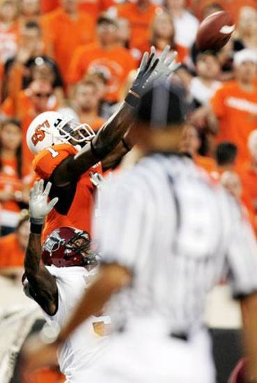OSU's Dez Bryant leaps for catch in front of Trevor Ford at the Oklahoma State University college football game against Troy University Saturday, Sept 27, 2008 at Boone Pickens Stadium in Stillwater, Oklahoma. BY SARAH PHIPPS, THE OKLAHOMAN