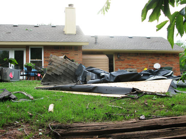 The winds peeled off the roof of Reggie Ayers? home and dumped it in his backyard in the Hidden Valley addition in southeast Edmond. Photo by Lillie-Beth Brinkman, The Oklahoman