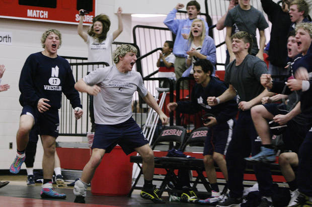 The Edmond North Huskies react as they win another match over the Muskogee Roughers at the class 5A and 6A Dual State wrestling finals at Claremore high school in Claremore, Okla., taken on February 9,2013. JAMES GIBBARD/Tulsa World