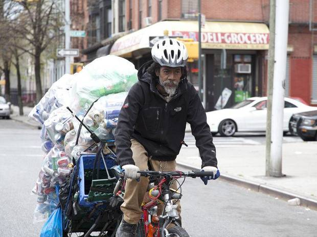 "A ""canner"" hauls the empty bottles and cans he has sifted out of the trash in a scene from the Oscar-nominated short documentary ""Redemption."" Photo provided. <strong></strong>"