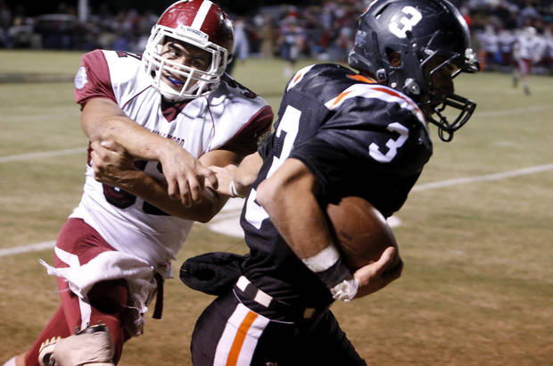 Wayne's Louden Johnson (3) stiff arms Wynnewood's Trey Knowles on his way to the end zone in the first half in high school Football on Friday, Oct. 26, 2012 in Wayne, Okla.  Photo by Steve Sisney, The Oklahoman