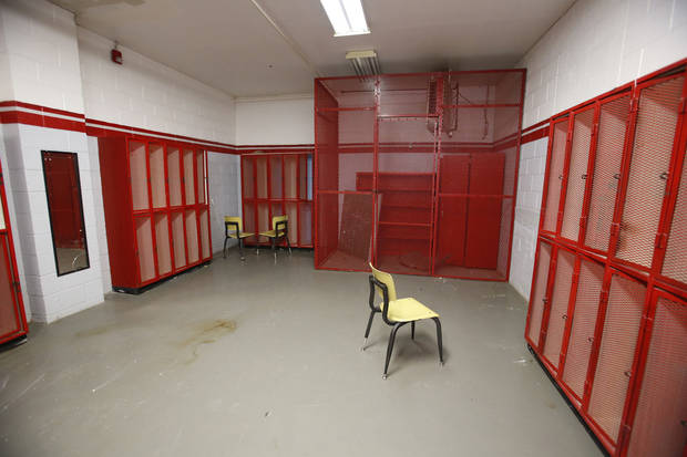 A locker room in the old gymnasium at Mustang High School in Mustang is shown.  School officials and the Mustang community are considering what the structure's future will be. <strong>Steve Gooch - The Oklahoman</strong>