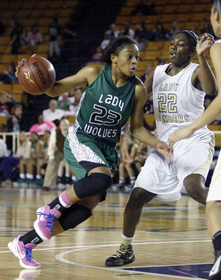 CLASS 6A GIRLS HIGH SCHOOL BASKETBALL / STATE TOURNAMENT: Edmond Santa Fe's Courtney Walker (left) drives against Midwest City's Adrianna White during a basketball game at Oral Roberts University in Tulsa on Friday, March 9, 2012. MATT BARNARD/Tulsa World