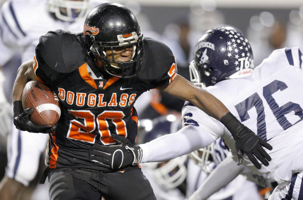 Aliston Cobb of Douglass runs past Joseph Christian of Star Spencer during the Class 4A high school football state championship game betweeen Star Spencer Douglass at Boone Pickens Stadium in Stillwater, Okla., Saturday, December 5, 2009. Photo by Bryan Terry, The Oklahoman