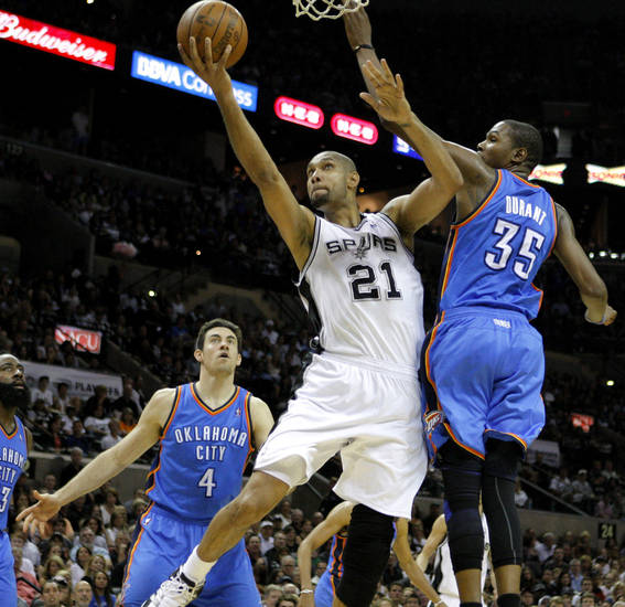 San Antonio's Tim Duncan (21) goes to the basket between Oklahoma City's Nick Collison (4) and Kevin Durant (35) during Game 1 of the Western Conference Finals between the Oklahoma City Thunder and the San Antonio Spurs in the NBA playoffs at the AT&T Center in San Antonio, Texas, Sunday, May 27, 2012. Oklahoma City lost 101-98. Photo by Bryan Terry, The Oklahoman