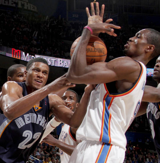 Oklahoma City's Serge Ibaka fights with Rudy Gay of Memphis for the ball during the NBA basketball game between the Oklahoma City Thunder and the Memphis Grizzlies at the Ford Center in Oklahoma City on Wednesday, April 14, 2010. 