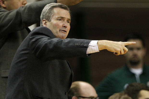 Northwestern coach Bill Carmody calls to his team in the first half of an NCAA college basketball game against Baylor on Tuesday, Dec. 4, 2012, in Waco, Texas. (AP Photo/Tony Gutierrez)