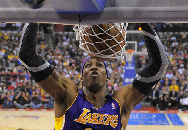 Los Angeles Lakers center Dwight Howard dunks during the first half of their NBA basketball game against the Los Angeles Clippers, Friday, Jan. 4, 2013, in Los Angeles.  (AP Photo/Mark J. Terrill)