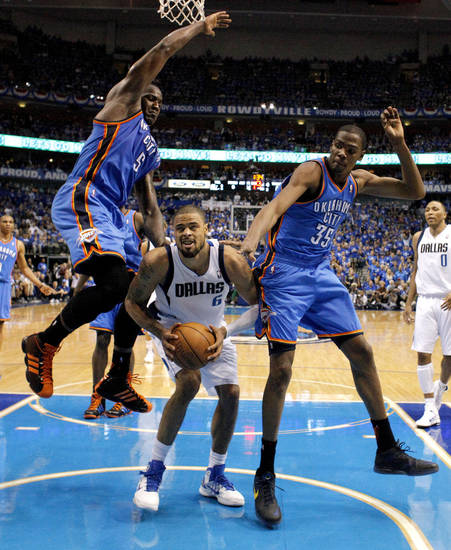 Oklahoma City's Kendrick Perkins (5) and Kevin Durant (35) defend Tyson Chandler (6) of Dallas during game 2 of the Western Conference Finals in the NBA basketball playoffs between the Dallas Mavericks and the Oklahoma City Thunder at American Airlines Center in Dallas, Thursday, May 19, 2011. Photo by Bryan Terry, The Oklahoman